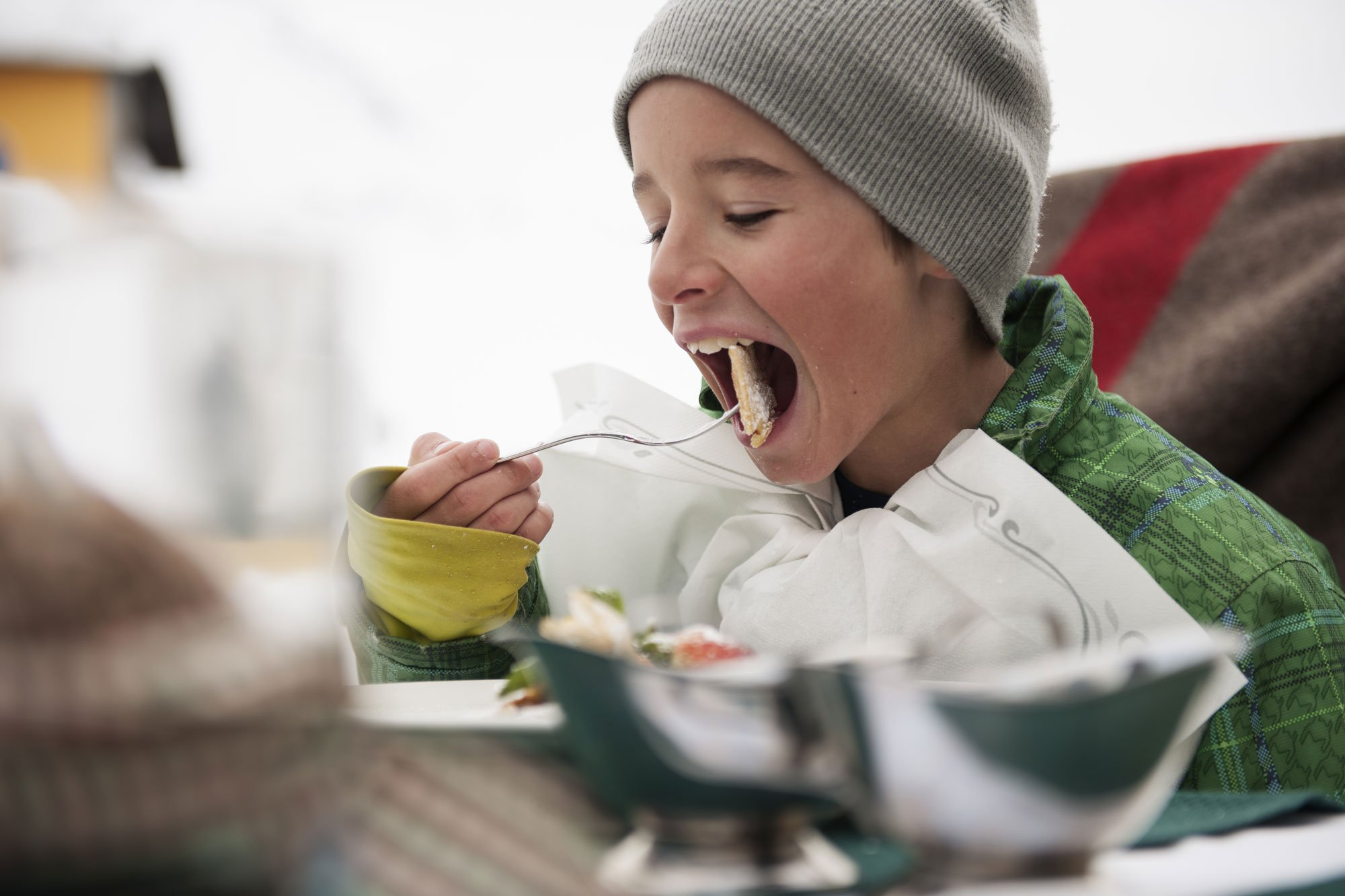 Skiing makes hungry. A young winter sportsmen enjoys his