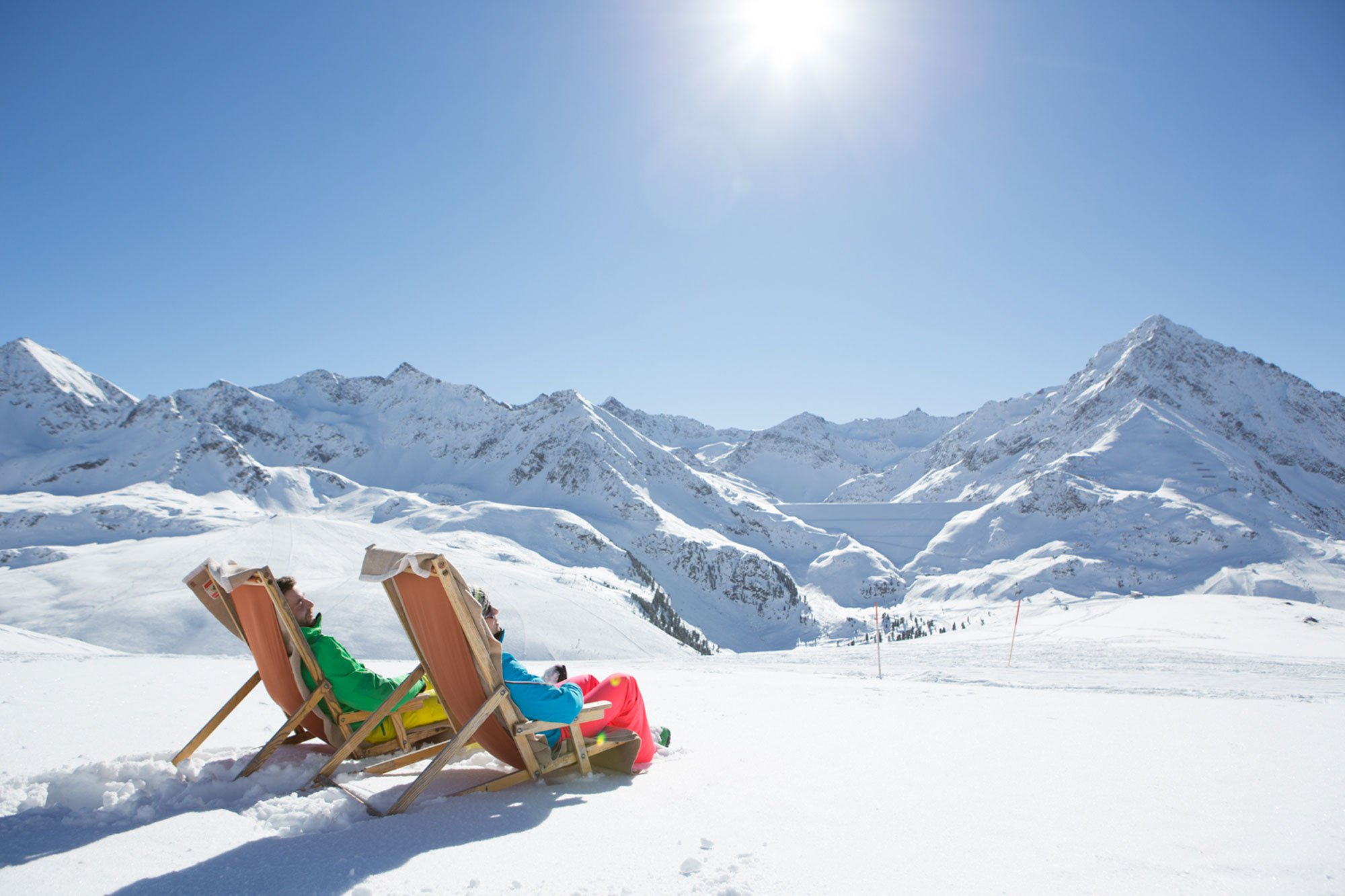 Sun bather with a great view to the greatest, snow-coverd peaks of Tyrol